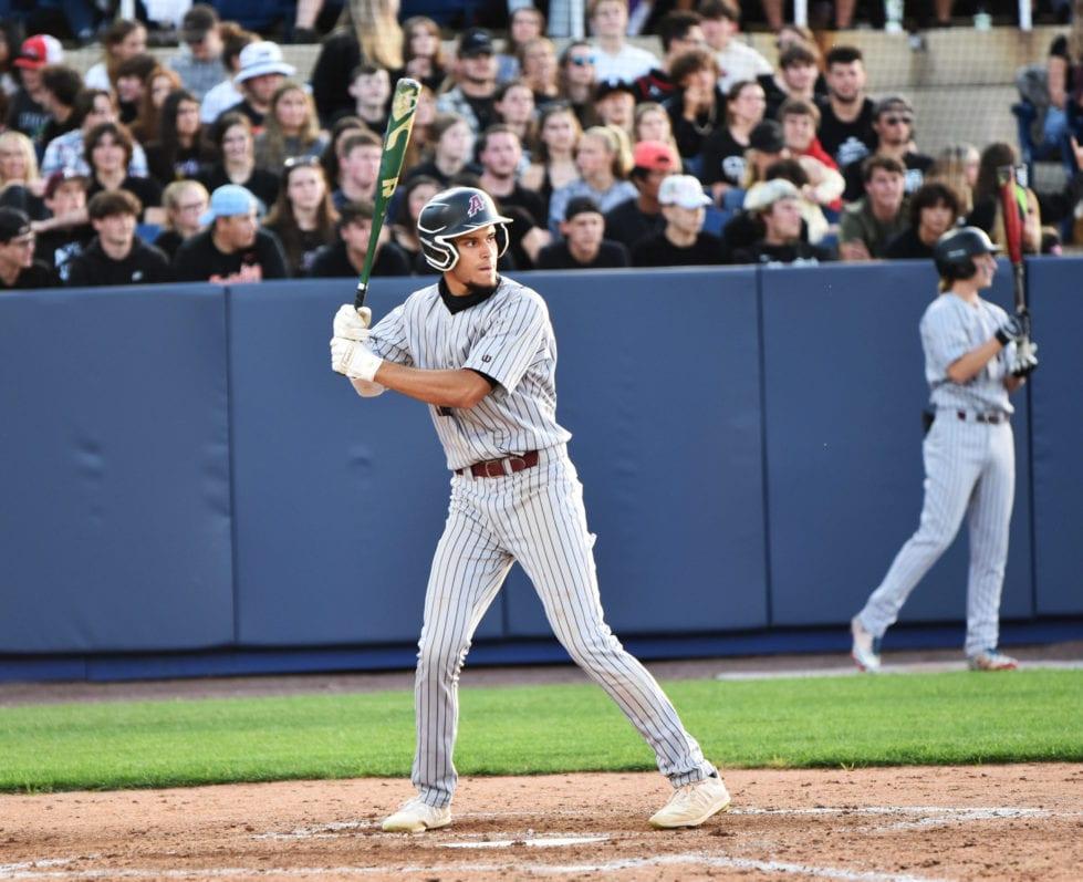a baseball player swinging a bat at a baseball game
