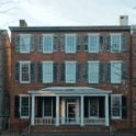 a large brick building with Dr Johnson's House in the background