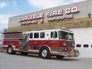 a fire truck parked in front of a building